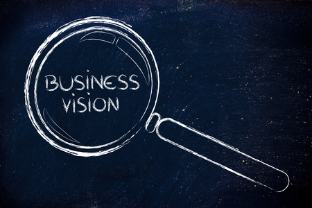 magnifying glass focusing on business vision and management photo