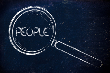 potentiality: magnifying glass focusing on people in business