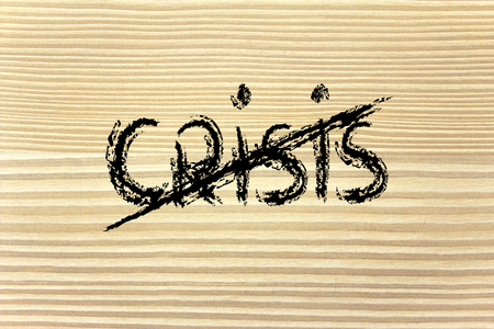 strikethrough: the word crisis with strikethrough, end of the crisis and new growth