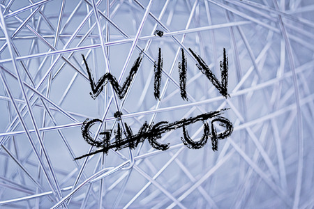 the words Give Up deleted and replaced by Win Stock Photo