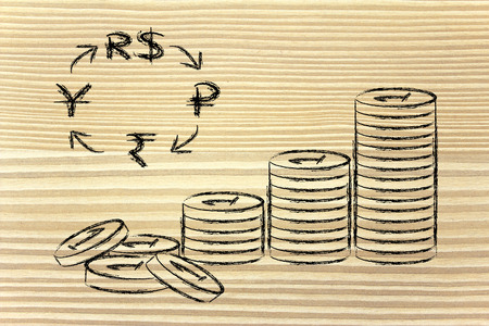 emerging markets: concept of exchange rates, coins and BRICS currency symbols