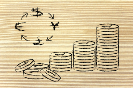 concept of exchange rates, coins and currency symbols photo