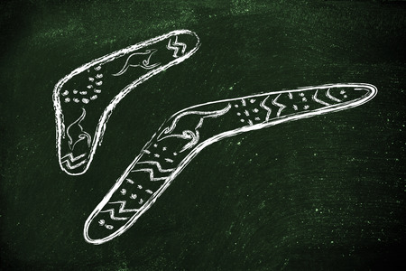 boomerangs: funny design of two australian boomerangs, the hunting tools that comes back, metaphor of cause-consequence