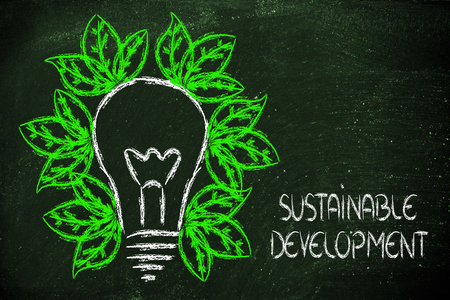 green economy and sustainability, conceptual image with foliage growing around an idea photo