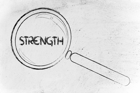 strenght: magnifying glass focusing on strenght, courage, determination