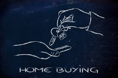 building sector: house key exchange, concept of buying or moving house Stock Photo