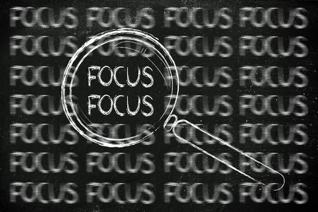 proper: magnifying glass showing proper focus surrounded by blurred writings