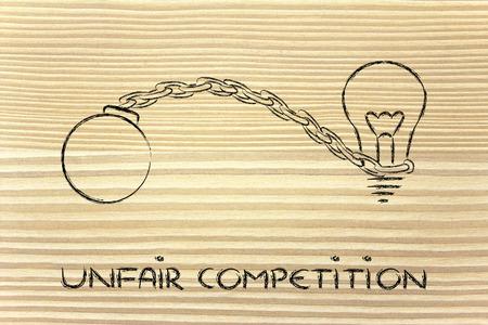 unfair: idea stuck with ball and chain, effects of unfair competition Stock Photo