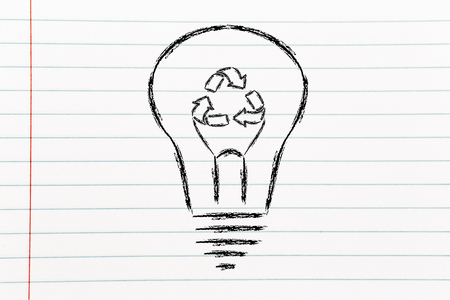 renewable energy concept: lightbulb with recycle sign as filament photo