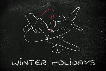 nye: airplane with santa claus hat: concept of Christmas and winter holidays