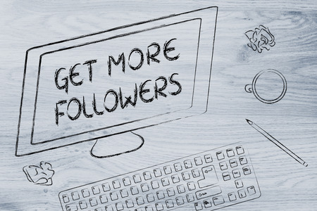 the text Get More Followers on a computer screen, on a desk with keyboard and coffee Stock Photo