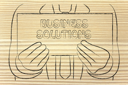 Business Solution sign in the hands of a business man