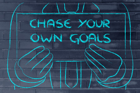 chase: Chase your goals, sign in the hands of a business man