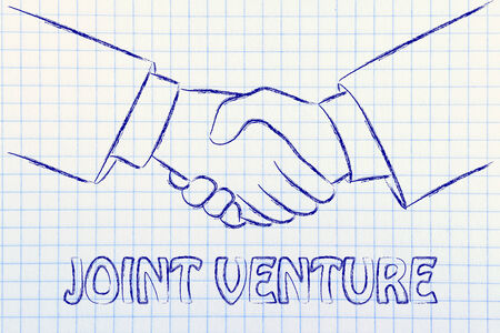 joint venture: business partners shaking hands: creating a joint venture
