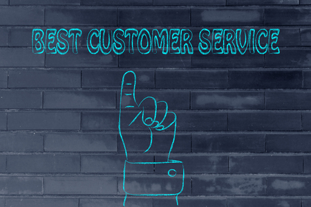 reach customers: hand pointing up at the concept of Best Customer Service Stock Photo