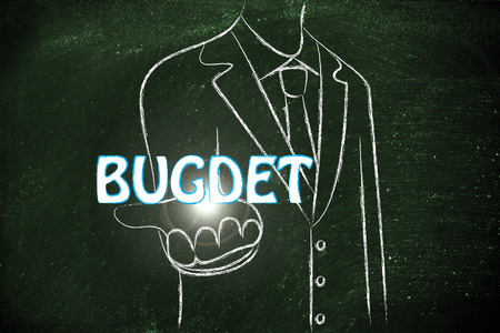 business man holding the word Budget Stock Photo
