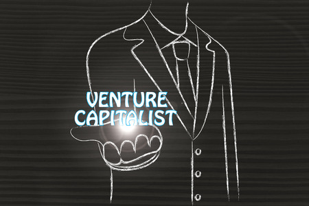 capitalist: business man holding the word Venture Capitalist
