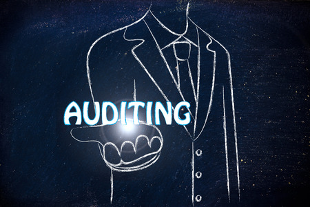 auditing: business man holding the word Auditing