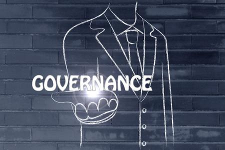 governance: business man holding the word Governance