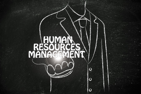 resources management: business man holding the word Human Resources Management