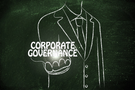corporate governance: business man holding the word Corporate Governance