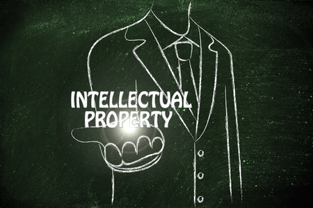 intellectual property: business man holding the word Intellectual Property