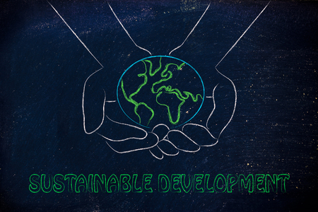 land management: green economy and ecology: metaphor of hands holding the planet
