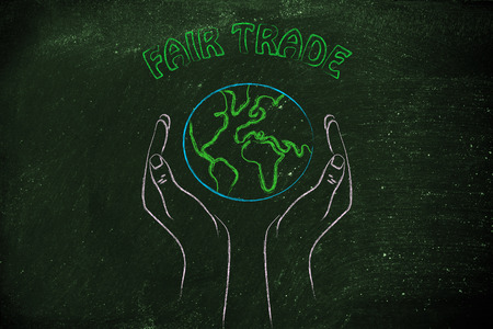 fair trade and respecting nature: metaphor of hands holding the planet