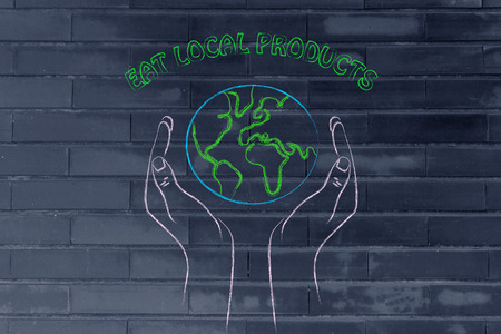respecting: eating locally and respecting nature: metaphor of hands holding the planet