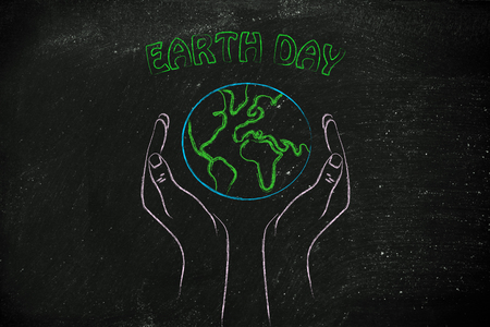 respecting: Earth Day and respecting nature: metaphor of hands holding the planet Stock Photo