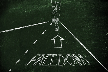 reaching your goals: man running on a road with directions towards freedom, concept of reaching your goals Stock Photo