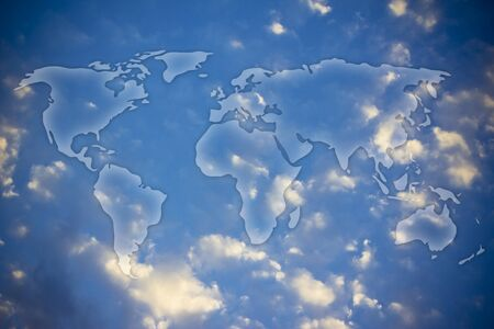 semi transparent glowing overlay creating the map of the world above the sky photo