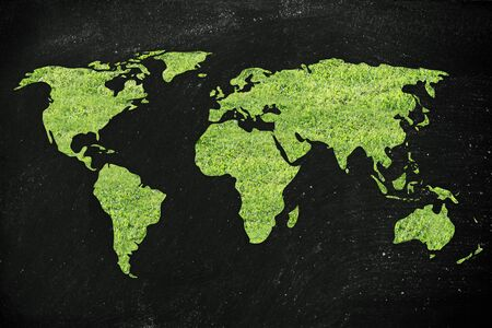 greeen: Green grass creating the map of the world Stock Photo