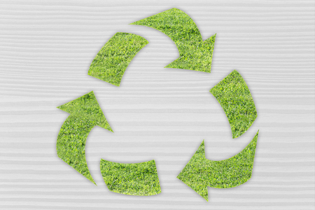 land management: green economy and ecology: symbol of recycling made of grass