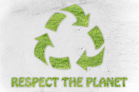land management: green economy and ecology: symbol of recycling made of grass with writing Respect the planet Stock Photo