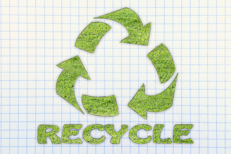 social behaviour: green economy and ecology: symbol of recycling made of grass