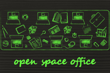 open space: open space offices and collaborating: laptops and office objects on shared desk
