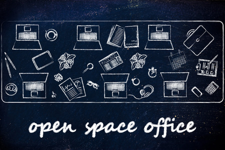 open space offices and collaborating: laptops and office objects on shared desk photo