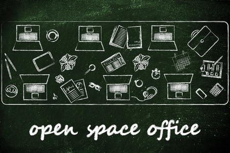 office space: open space offices and collaborating: laptops and office objects on shared desk