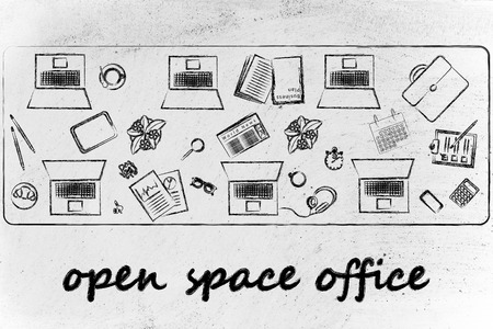 open space offices and collaborating: laptops and office objects on shared desk