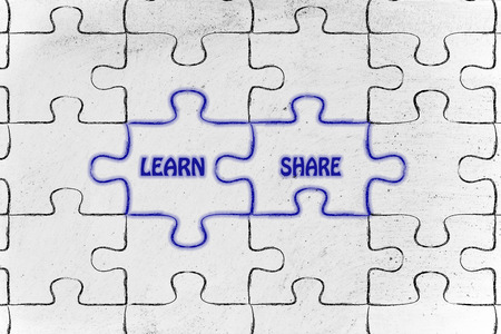 matching jigsaw puzzle pieces metaphor: learn & share Stock Photo
