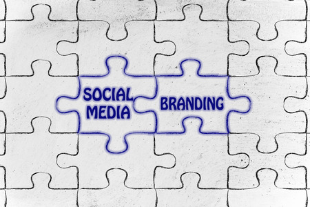 matching: matching jigsaw puzzle pieces metaphor: social media & branding Stock Photo