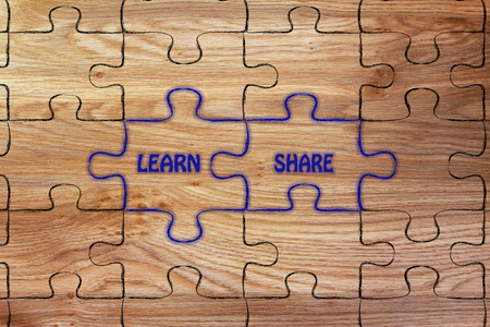 matching: matching jigsaw puzzle pieces metaphor: learn & share Stock Photo