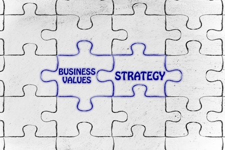 matching: matching jigsaw puzzle pieces metaphor: business values & strategy Stock Photo