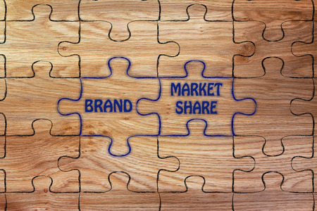 market share: matching jigsaw puzzle pieces metaphor: brand & market share Stock Photo