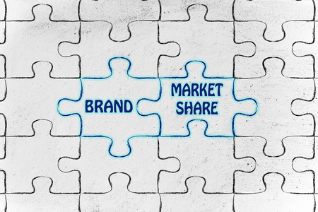 market share: matching jigsaw puzzle pieces metaphor: brand & market share Stock Photo