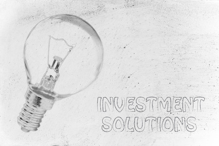 investment solutions: brilliant ideas for investment solutions, illustration with real lightbulb Stock Photo