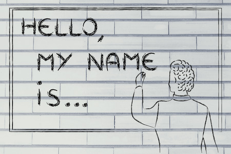 introducing: Hello, my name is..., new teacher introducing himself and writing his name on blackboard