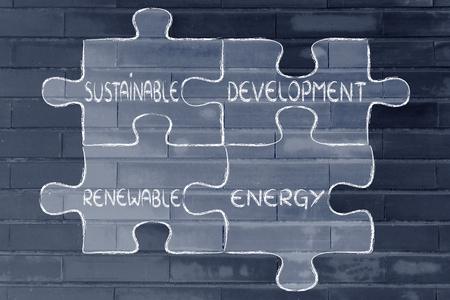 desarrollo sostenible: elementos de la economía verde como piezas de rompecabezas: el desarrollo sostenible y las energías renovables Foto de archivo