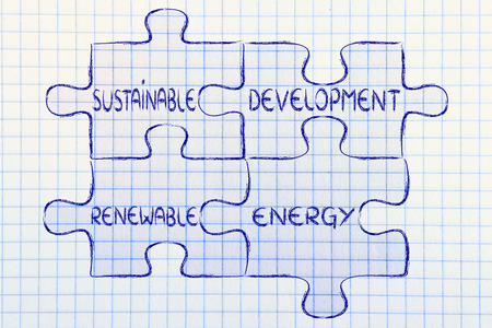 sustainable development: elements of the green economy as pieces of puzzle: sustainable development and renewable energy Stock Photo